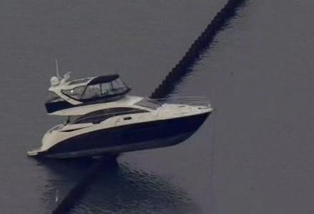 Yacht freed from a break wall in Oakland-Alameda Estuary