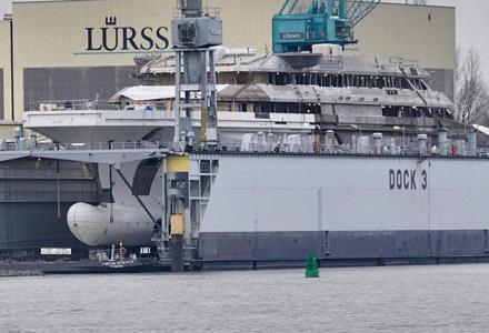 142m Lurssen Project Redwood moved to floating dock