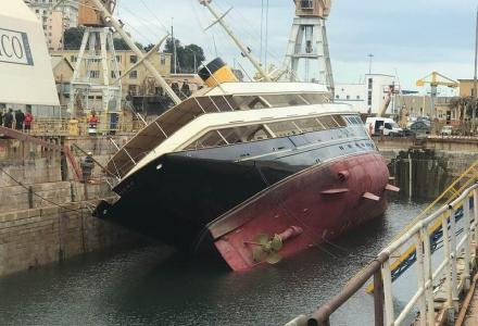 90m Corsair charter superyacht Nero listed to port in dry dock in Genova