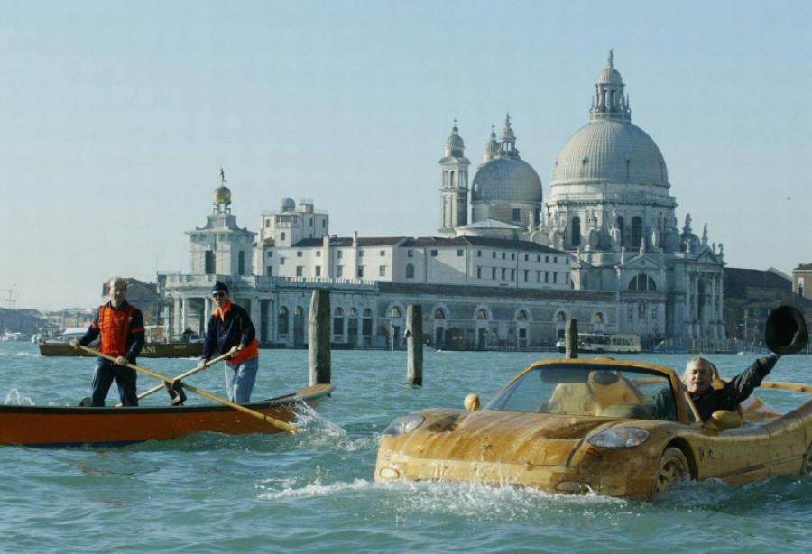Floating wooden Ferrari makes waves in Venice , Yacht Harbour